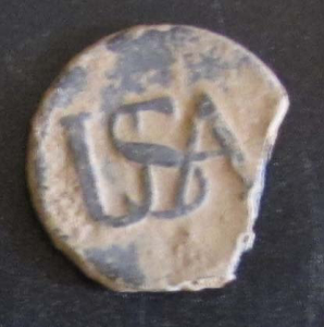"Pewter ""USA"" Continental Army button worn by a Revolutionary War soldier sometime between 1775 and 1783"