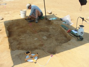 Joell Browning excavates the small sunken-floored building west of the cellar hole