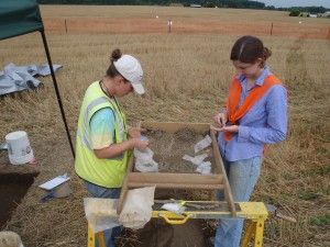 Morgan MacKenzie and Robin Cleland count some of the thousands of artifacts found during the plowzone sampling.
