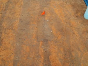 Crossing plow scars cut through a feature uncovered at the Houston-LeCompt site.