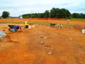 Johnie Sanders, Morgan MacKenzie, and Nathan Sims begin to uncover the root cellar.
