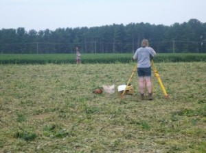 Katie Rettinger and Joelle Browning (HRI) shooting in the survey grid with a total station