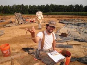 Archaeologist Matt Sanna holds a stirrup