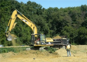Excavator working at the Bird-Houston Site