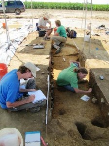 Archaeologists Jonathan Lewis, John Potts, Kevin Enlow, and Brian Manser excavating a large 19th-century cold cellar beneath a possible earthfast house