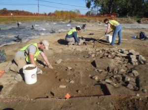 Dovetail's Jon Lewis, Kerry Gonzalez, and Sara Poore expose a building foundation at the Armstrong-Rogers site.