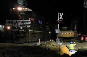 US Route 40 Railroad Crossing work occurs simultaneously with train traffic
